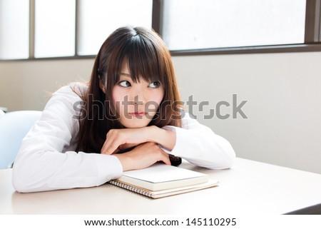 young asian schoolgirl studying - stock photo