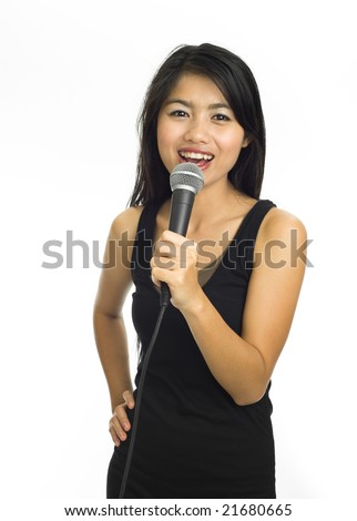 Young asian singing with microphone - stock photo