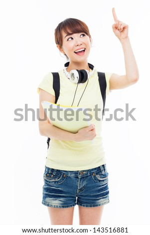 Young Asian stdudent girl pointing up space isolated on white. - stock photo