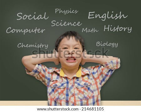 Young Asian student covering ears in front of chalkboard  - stock photo