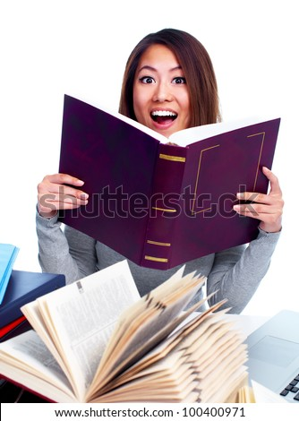 Young asian student girl reading the book. Isolated on white background. - stock photo