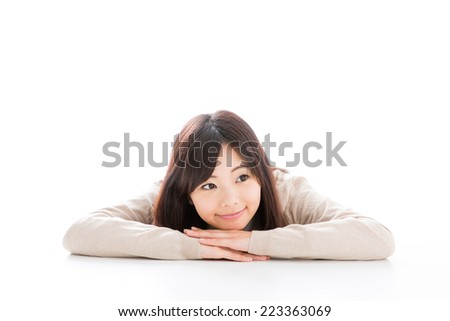 young asian student relaxing on white background - stock photo