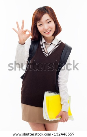Young Asian student show okay sign isolated on white background. - stock photo