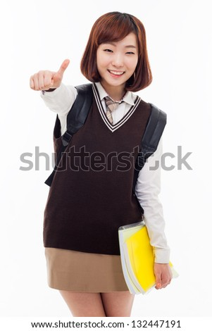 Young Asian student show thumb isolated on white background. - stock photo