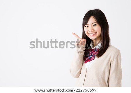 young asian student showing on white background - stock photo