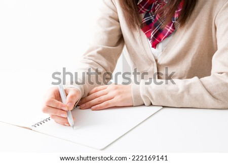young asian student studying in the white room - stock photo