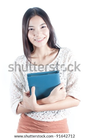 Young asian student with her blue notebook on white background, education concept - stock photo