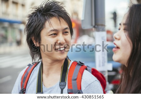 Young Asian Tourists Talking - stock photo