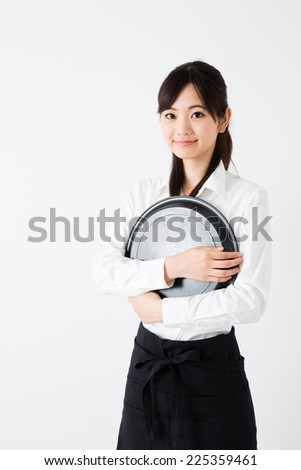young asian waitress on white background - stock photo