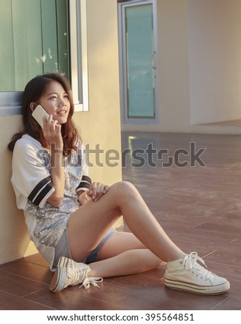 young asian woman and smart phone in hand - stock photo