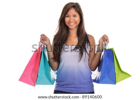 Young Asian woman carrying shopping bags isolated on white - stock photo