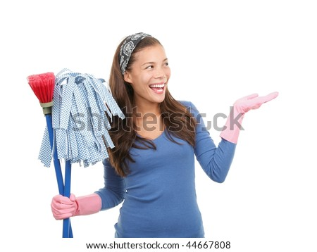 Young asian woman cleaning and presenting your product or message at the side. Isolated on white background. - stock photo