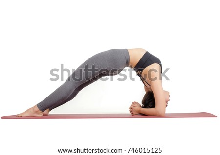 young asian woman doing yoga in Dwi Pada Viparita Dandasana or Two-Legged Inverted Staff pose on the mat isolated on white background, exercise fitness, sport training and healthy lifestyle concept