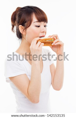Young Asian woman eat sandwhich ioslated on white.