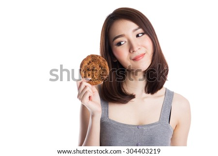 Young asian woman eating chocolate chip cookies, isolated on white background. - stock photo