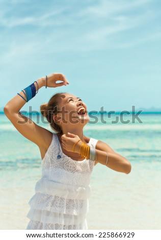 Young asian woman enjoying the sun - stock photo