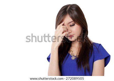 Young Asian woman feeling dizzy, with her hand covering her face, isolated on white background