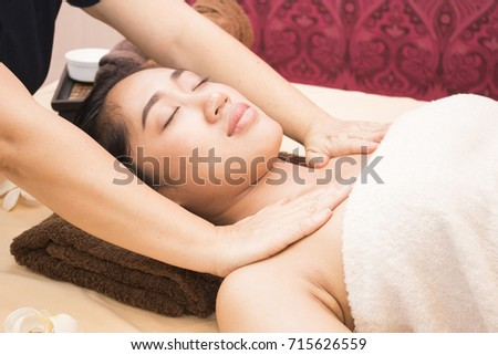 Young asian woman getting thai massage in spa