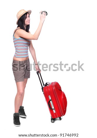 Young asian woman going on vacation with her camera and suitcase.