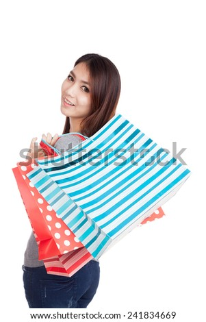 Young Asian woman happy with shopping bag  isolated on white background
