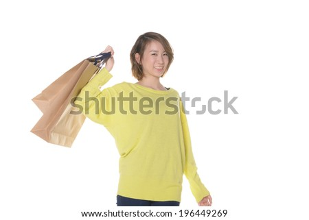 Young Asian woman having shopping bags, isolated on white background.