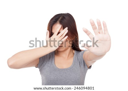 Young Asian woman hide her face with hand  isolated on white background