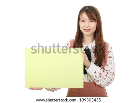 Young asian woman holding a blank white board - stock photo