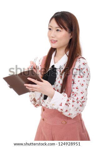 Young asian woman holding a leather notebook isolated on white background - stock photo