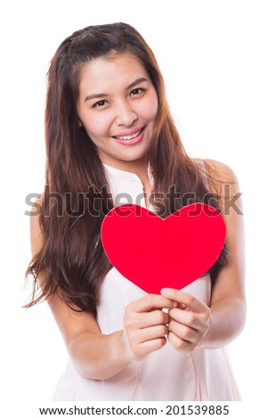 Young asian woman holding a red heart symbol