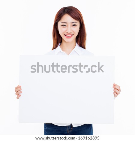 Young Asian woman holding a white borad isolated on white background.
