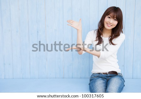 Young Asian woman holding hands with space for copy