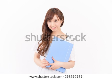 young asian woman holding reports and looking at camera.