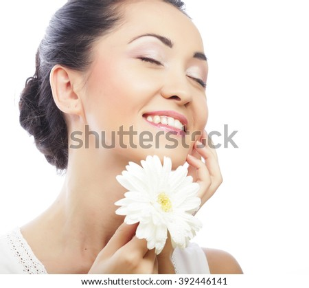 young asian woman holding white gerber flower - stock photo