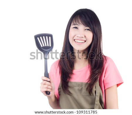 Young asian woman housewife with apron on white background - stock photo