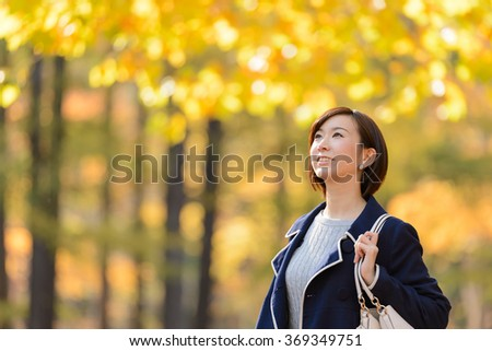 Young Asian woman in Autumn Forest. - stock photo