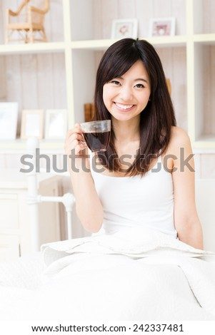 young asian woman in the bed room lifestyle image