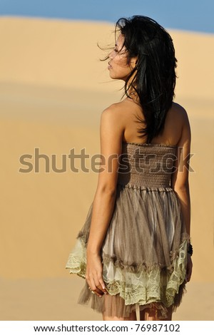 Young Asian woman in the dunes - stock photo