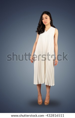Young asian woman in white dress looking at the space for text on white isolate with clipping path - stock photo