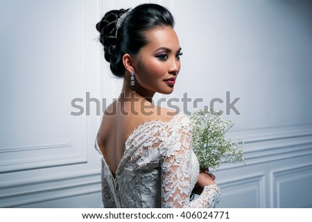 Young asian woman in white dress with flowers fashion portrait - stock photo