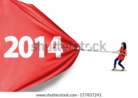 Young asian woman is pulling new year of 2014 to change the new future isolated - stock photo