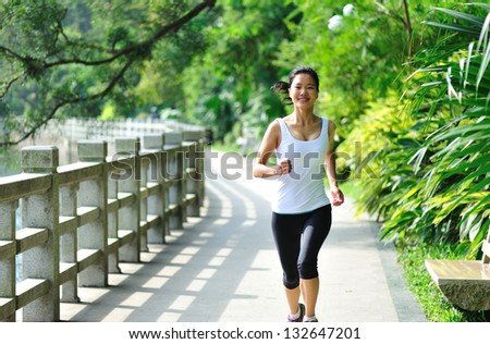 young asian woman jogging