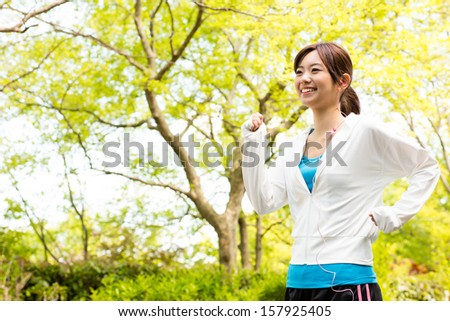 young asian woman jogging in the park - stock photo