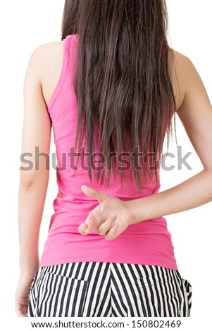 Young asian woman keeps fingers crossed. Rear veiw. Isolated on the white background. - stock photo