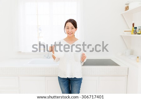 young asian woman kitchen image