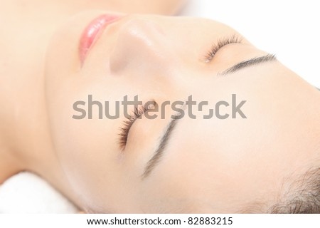 Young Asian woman lashes - stock photo