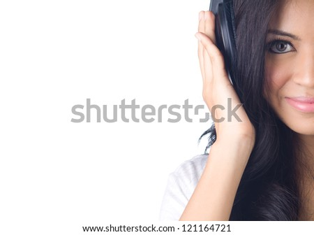 Young asian woman listening to music on white isolated - stock photo