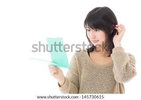 young asian woman looking mirror on white background