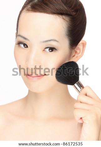 Young Asian woman makeup - stock photo