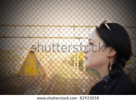 young asian woman on the background of the industrial landscape - stock photo
