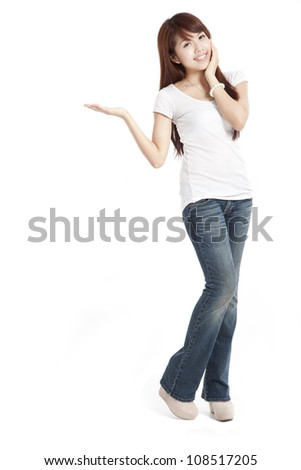 young asian woman presenting and showing copy space for product - stock photo